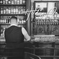Holding on par Jon Gonzalez